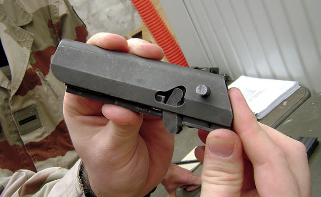Close examination of the locking lever used with the delayed blowback operation—note also the extended disassembly pin. This pin, when out of battery, allows the lever to rotate up far enough to permit the bolt/bolt carrier to be slid farther aft and removed from the receiver. After removal from the receiver, the bolt can pivot down in order to be removed from the bolt carrier.