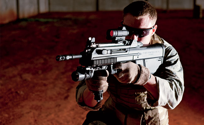 The F2000 was developed in the late 1990s for urban combat after militaries found standard carbines too long and cumbersome. The rifle also corrected several other flaws common to bullpup designs. It is fully ambidextrous, has weather seals to guard against dust and dirt, and can mount a full range of accessories.