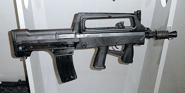 The short-barreled carbine version of the QBZ95 features a full-size forehand grip and a more sophisticated muzzle compensator for reducing the additional flash and recoil. Also specific to this 5.56mm variant is the different receiver with a deeper magazine well and the use of an M16-style magazine.