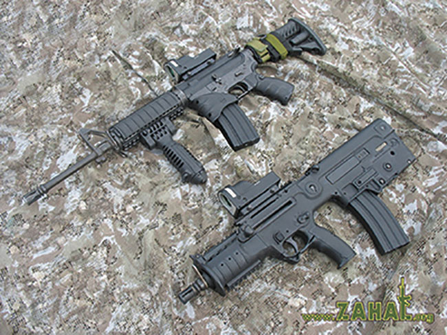 A Micro TAR-21 with its 13-inch barrel compared to a 16-inch-barreled M4 carbine. Even with its stock collapsed, the M4 is nearly six inches longer than the Tavor. Photo courtesy www.zahal.org