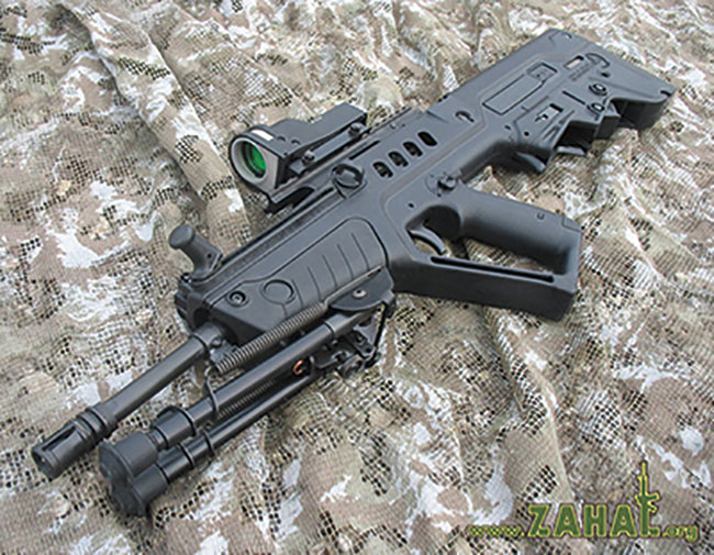 A Tavor TAR-21 with its folding bipod, mounting a Meprolight Mepro-21 self-illuminated reflex sight. It has a large cocking handle and sling attachment points. Photo courtesy www.zahal.org