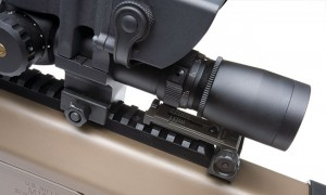 A folding backup rear sight is easily tucked under the Leupold MK IV scope.  The folding front sight is actually buried in the front of this rail.