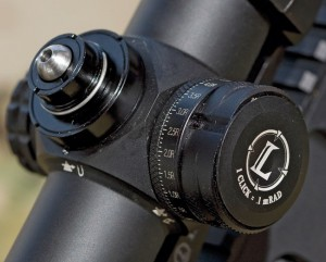 With the top turret cover removed, a carefully engineered ball detent rises above the secret in Leupold's new pinch-locking elevation turret. Adjustments are made on the Mark 8 CQBSS in .1 mil increments.