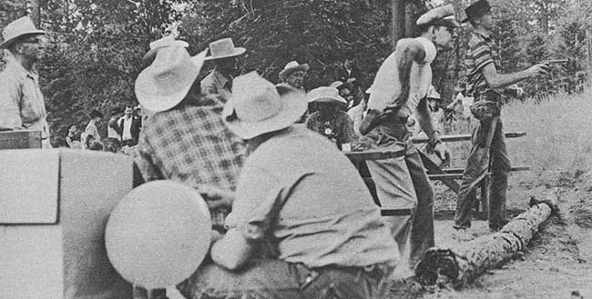 Difference in speed between these two gunslingers is apparent immediately in this photograph. A target balloon is seen in the foreground.