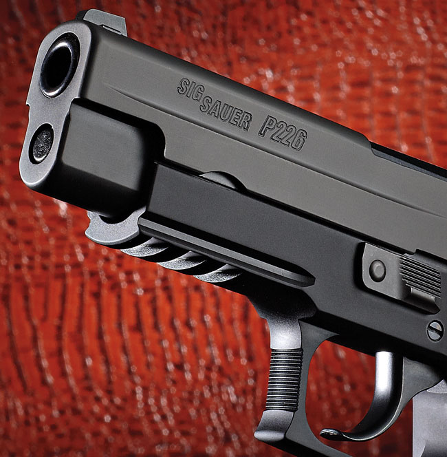 The P226 E2 sports a rail on the dustcover, a shorter reach to the trigger and a much shorter reset on that same trigger.