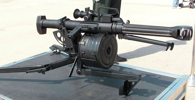 The QLZ-87 35mm automatic grenade launcher is a derivative of the Type 85 12.7mm HMG. It uses a similar tubular receiver, direct-gas operation, Degtyarov flap lock and side-mounted fire control.