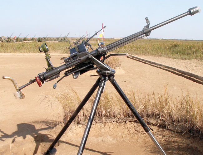 ype 77 in anti-aircraft configuration with the wide-angle optical AA sight. Because of its unusual direct-gas-impingement operation, it only has a small gas tube underneath the barrel and features a distinctive tubular receiver.