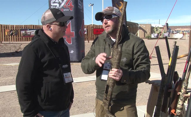 OSG senior digital editor Lynn Burkhead visits with Rafe Nielson of Winchester at Industry Day at the Range about the upgraded Universal Hunter version of Winchester's Super X4 shotgun.