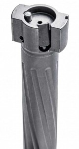 The M16-style extractor sits atop the recoil lug. A 45-degree bevel on the left side of the extractor might help longer fired cases avoid the scope's windage turret on exit.