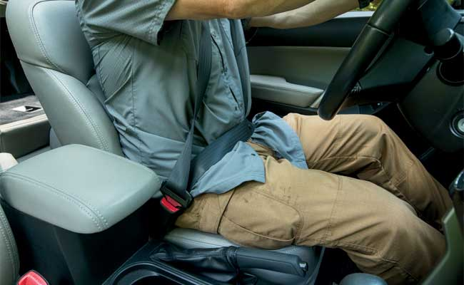 Concealed yes, but accessible no. With the seat belt over the concealment garment it is going to make for slow access.