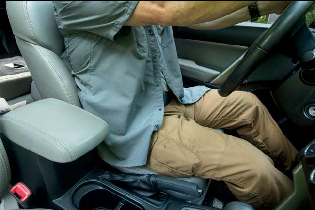 Seatbelt is attached and the cover garment is pulled free to give the shooter quick access to the pistol while still offering concealment.