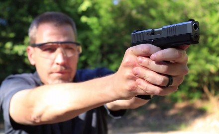Patrick Sweeney and James Tarr feature a pair of 9 mm pistols from Kahr.