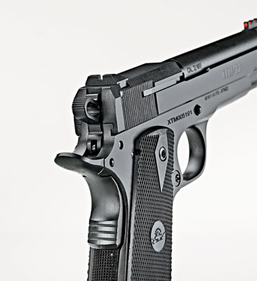 With the reduced mass of the slide, cocking serrations are only at the rear. Rear sight is fixed in a transverse dovetail.