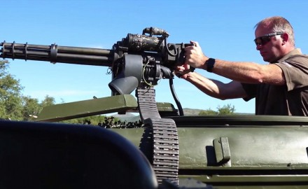 Tom Beckstrand puts the 7.62 minigun into action while visiting the Drivetanks.com facility in