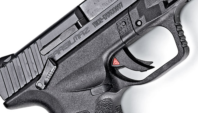 The trigger includes a safety familiar to Glock users. The red indicator lets us know the striker is charged and ready.