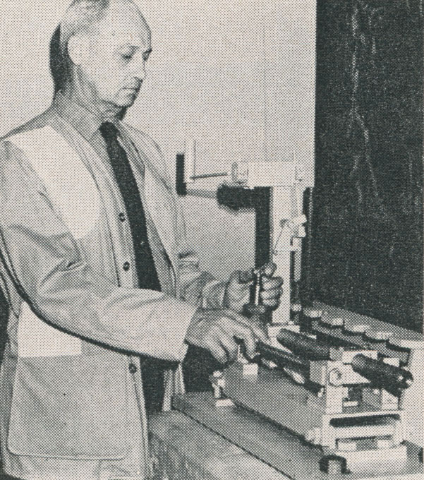 B. E. Hodgdon with his copper crusher pressure gun, part of test equipment.