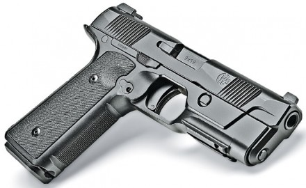 Cy and Lauren Hudson innovated a low bore axis,  striker system with handling attributes of a 1911.