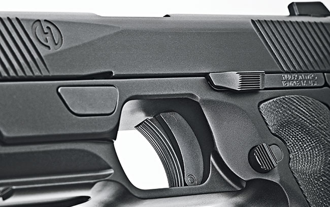 The controls are all in their expected places. However, the takedown plate is that trapezoid push-button rotating lever located above and forward of the 1911-ish trigger.