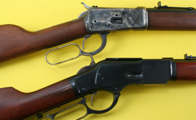 Winchester's Model 1892 (top) was designed to be a cheaper, easier to manufacture replacement for the Model 1873 rifle. As an added bonus, the action on the 1892 was also much stronger than the earlier rifle.