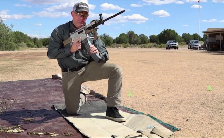 Tom Beckstrand talks with gun designer Jim Sullivan about his switch barrel design for MGX rifle.
