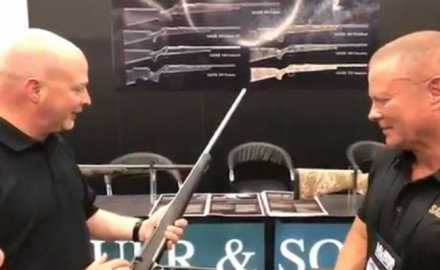 Lynn Burkhead stops by the Sauer USA booth to talk with Tip Burns during the 2018 NRA Annual