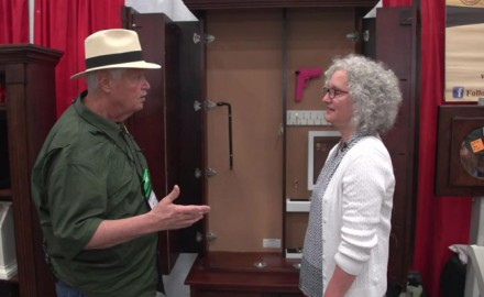 OSG's Michael Bane talks to to Jill Herro, owner, designer, and builder, of Secret Compartment Furniture at the 2018 NRA Annual Meeting & Exhibits.