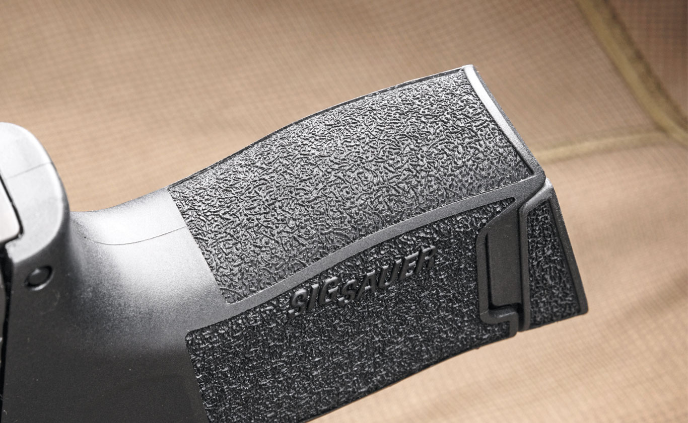 The back of the triggerguard is deeply undercut, which allows for a high firing grip.