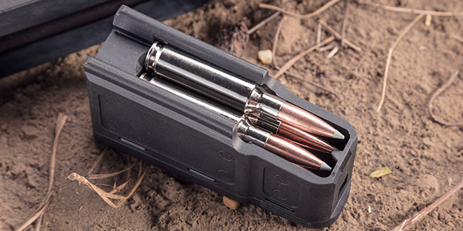 The double-stacked polymer magazine holds five standard or four mini/magnum cartridges and, thanks to its construction, hides neatly away inside the stock.
