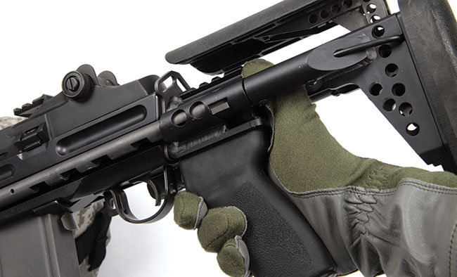 The newest Sage International EBR chassis carries an ERGO pistol grip. The stock can be collapsed while shouldered without injury to the shooting hand. A bullet tip can be used to depress a small detent and adjust the comb height.