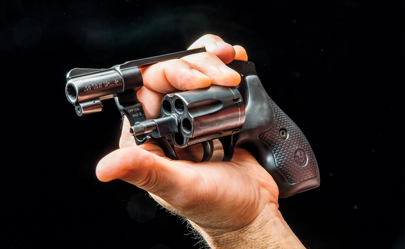 A detailed look at the unload/reload grip on a revolver. Note that the two front fingers push the cylinder out, while the ring and small finger remain outside of the frame to help control it, allowing the thumb to eject the spent casings.