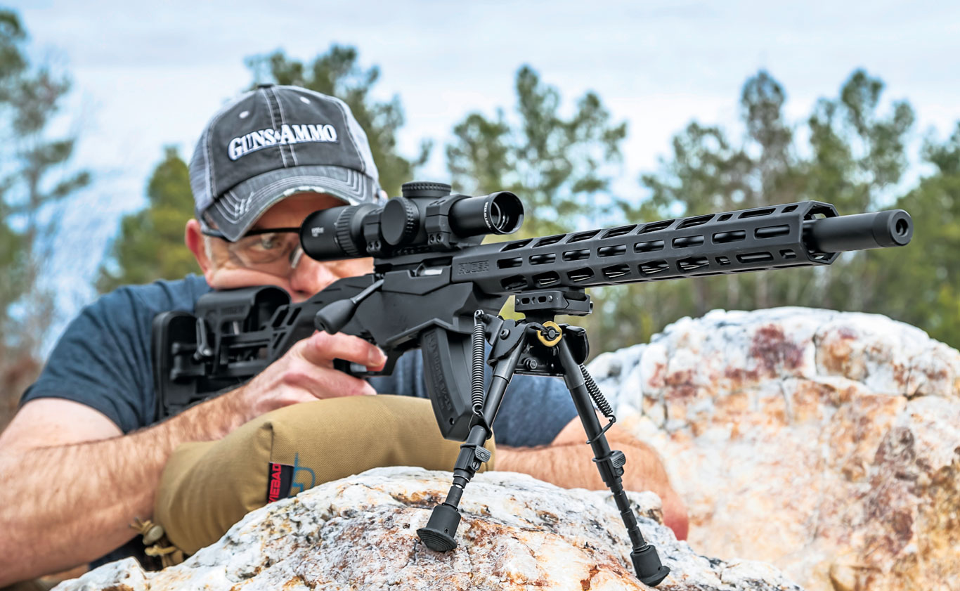 Moving the bipod closer to the receiver and stuffing a jacket or shooting bag under the pistol grip is a great way to stabilize both the front and rear of the rifle on a narrow or uneven support.