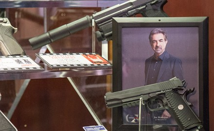 Actor Joe Mantegna of Criminal Minds and Gun Stories SIG SAUER 1911 TACOPS Pistol placed into the NRA Museum's Hollywood Gun Exhibit. Photo Credit: Forrest MacCormack, NRA Staff