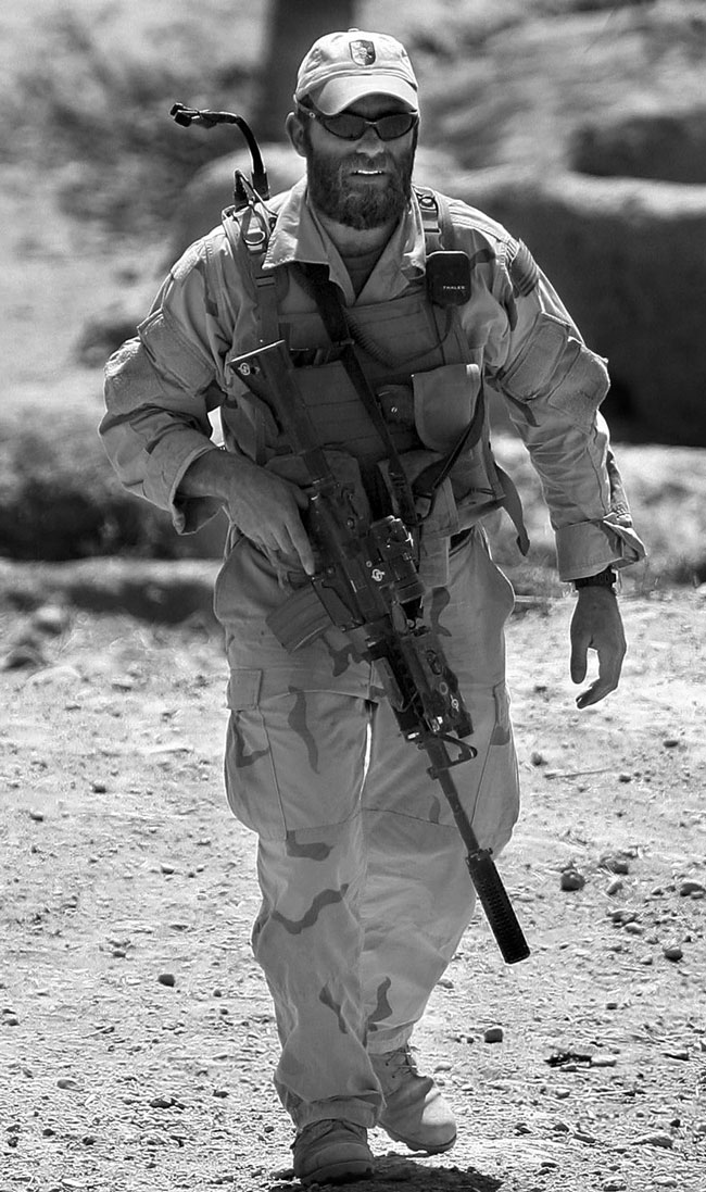 Captain Beckstrand conducting a patrol in Afghanistan in 2004, complete with his SOPMOD M4A1, equipped with an Aimpoint COMP M2 red dot sight.