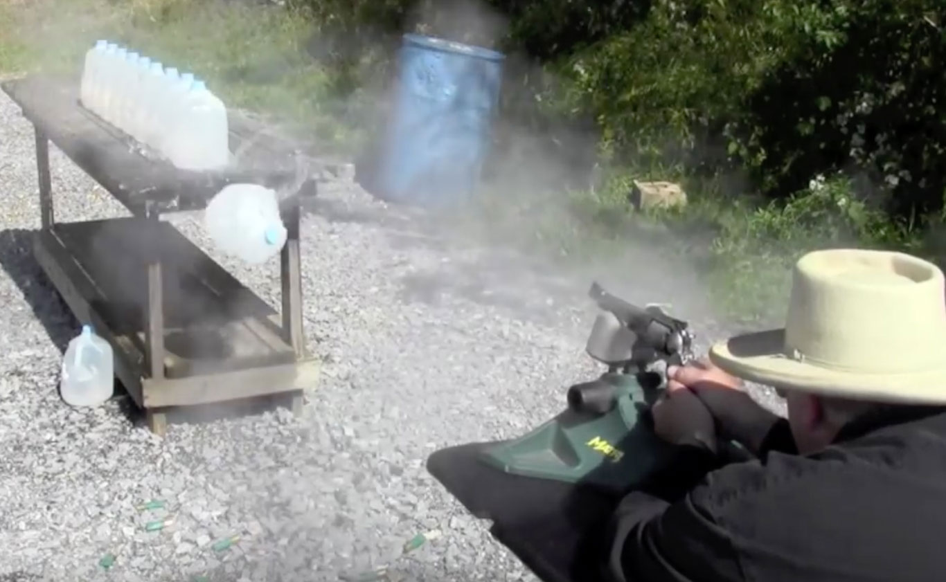 The author firing .44 caliber projectiles into rows of wart jugs to test penetration.