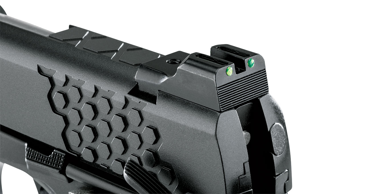 Kimber's use of fiber-­optic sights with long tubes means that these are bright and easy to see in various light conditions. The rear features a ledge with which to rack the slide one-­handed.