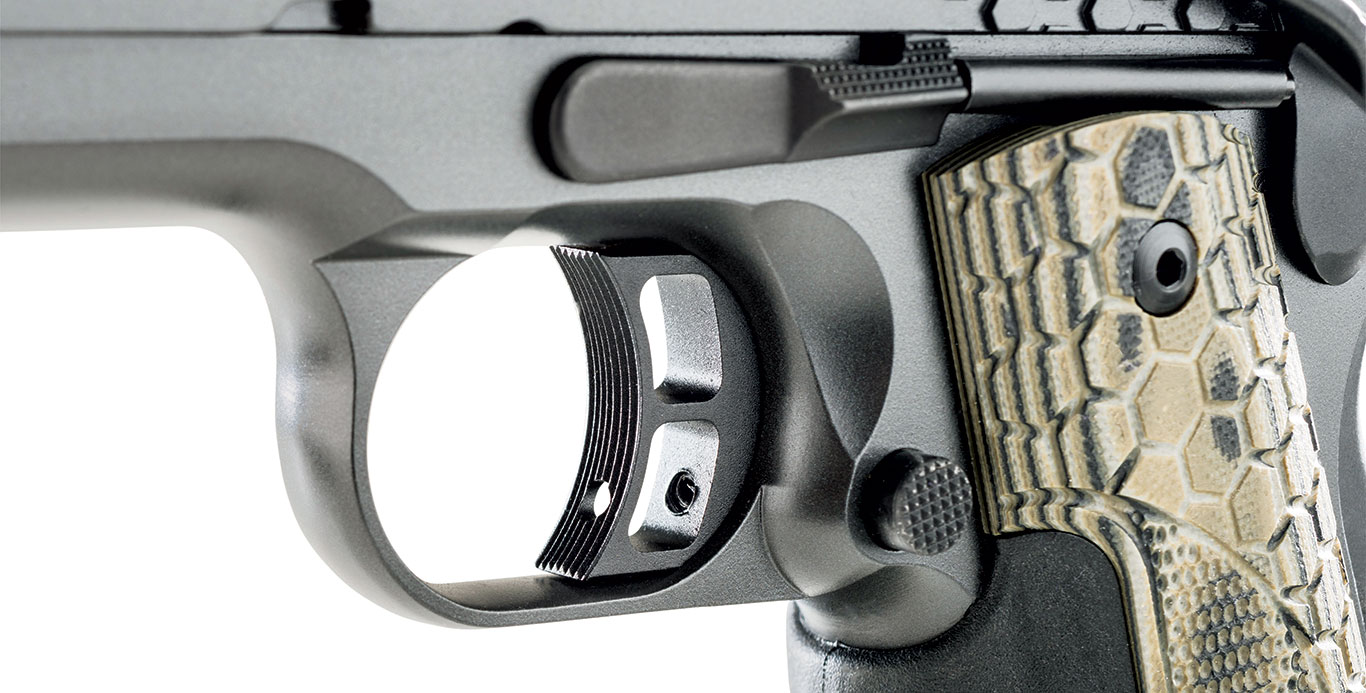 The trigger shoe is uniquely skeletonized with two ports, yet the touchpoint still wears serrations and offers access to adjust takeup with an Allen wrench. Other controls are familiar to 1911 shooters.