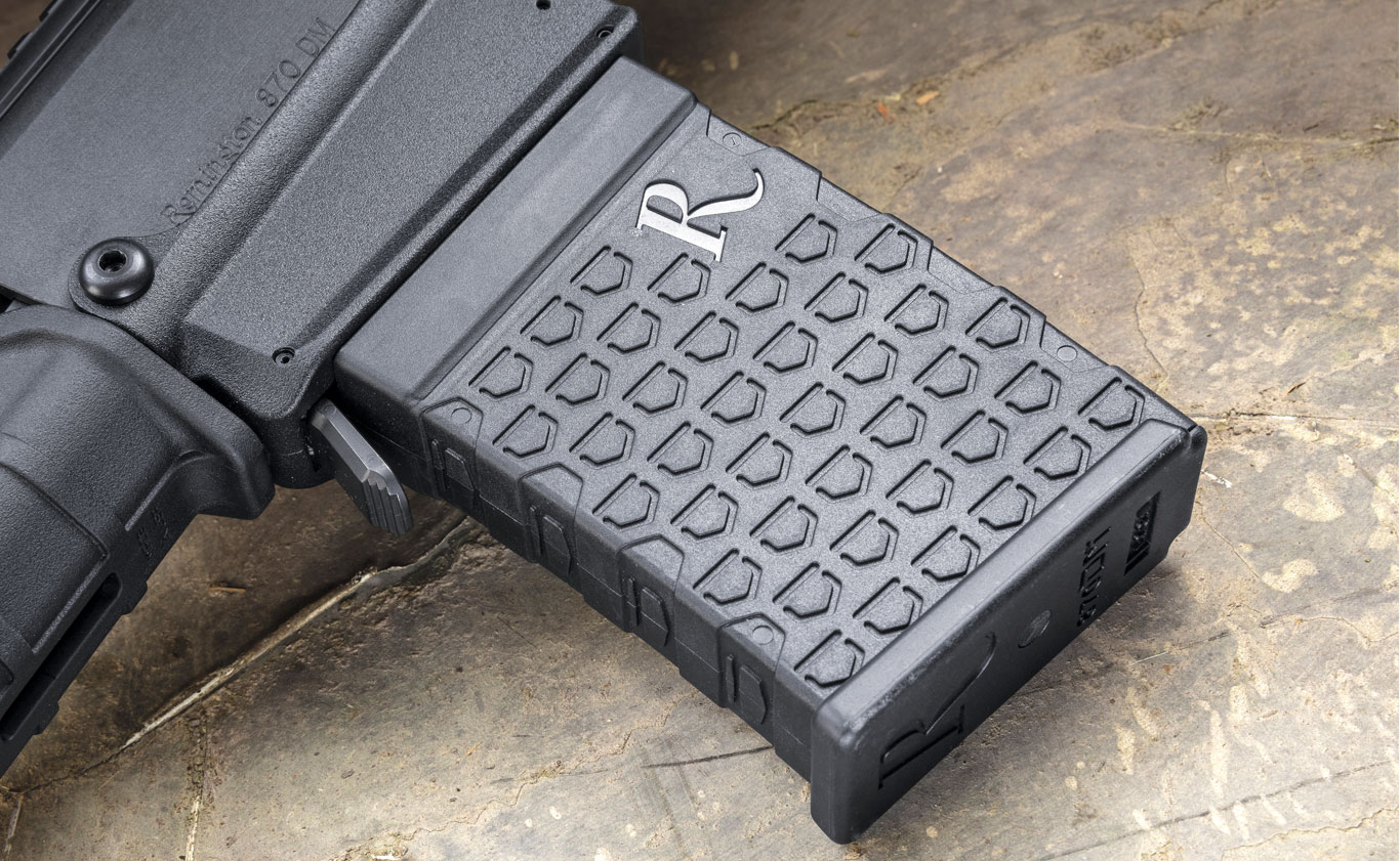 The detachable box magazine is constructed of polymer and steel, and carries six shells. Shield-graphic texturing provides grip during insertion or removal. G&A's testing showed the magazines will not drop from the receiver, but need to be pulled from the magazine well.