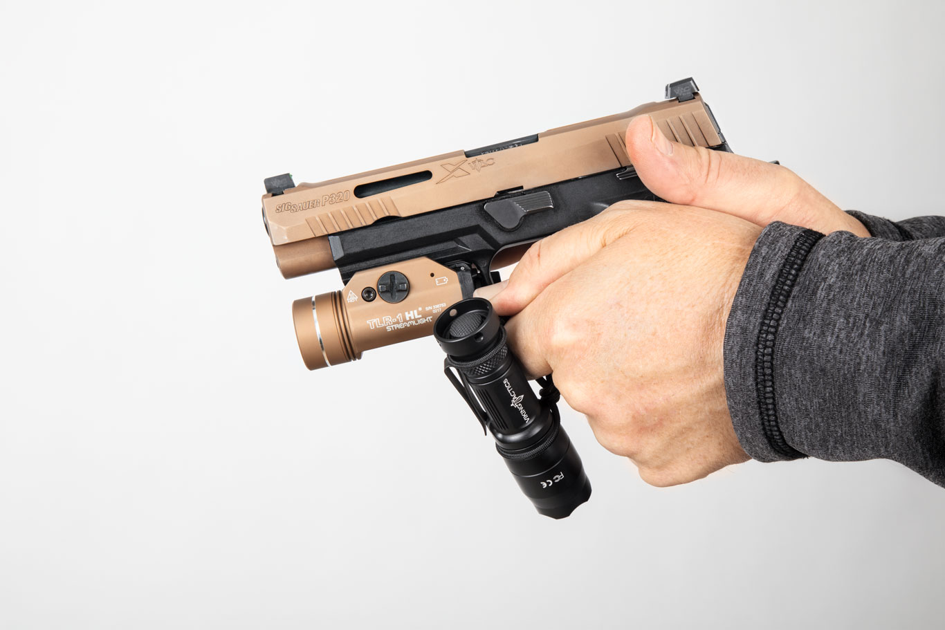 With the bungee, the light can stay at the ready even during operation of the pistol- mounted light.