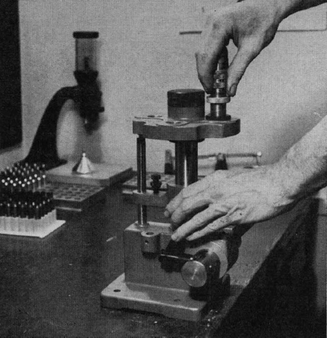 The first mechanical operation is the resizing and decapping of the cartridges. Here the resizing die is screwed into place on a Lyman All-American turret tool for the operation.