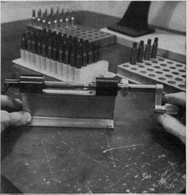 Trimming of the brass cases, if necessary, is performed after resizing. Undue lengthening of cases can increase chamber pressures. This is the Forster-Appelt col/et-type trimmer.