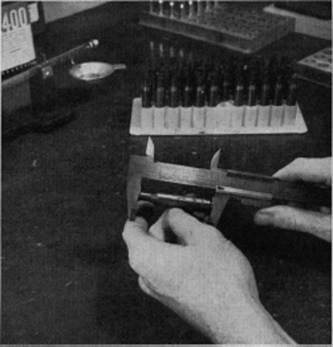 A good vernier caliper aids in checking the overall length of cartridge cases. An inexpensive tool, graduated to hundredths of an inch is adequate. It has many other uses, too.