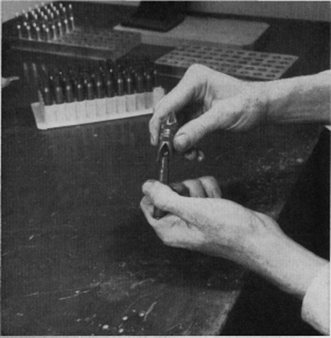 A de-burring tool, such as this Wilson, is handy for chamfering both the outside and inside of the case mouth ofter trimming. A light going-over is all that is necessary to remove rough edges resulting from trimming.