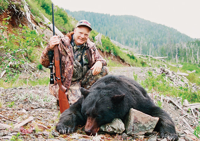 //www.gunsandammo.com/files/boddingtons-best-calibers-for-north-american-big-game-hunting/boddington_best_black_bear.jpg