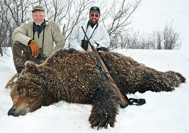 //www.gunsandammo.com/files/boddingtons-best-calibers-for-north-american-big-game-hunting/boddington_best_grizzly_bear.jpg