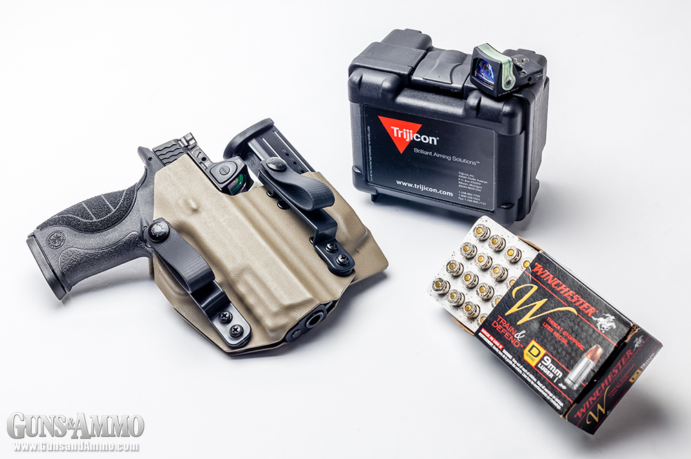 //www.gunsandammo.com/files/mini-red-dot-sights-for-concealed-carry/trijicon_rmr_concealed_carry_smith_wesson-m-p-c-o-r-e-9-pistol_holster_17.jpg