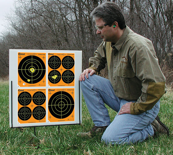 //www.gunsandammo.com/files/products-for-young-shooters/caldwell-orange-peel-portable-target-stand-kit.jpg
