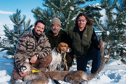 bowhunters and dog with harvested mountain lion