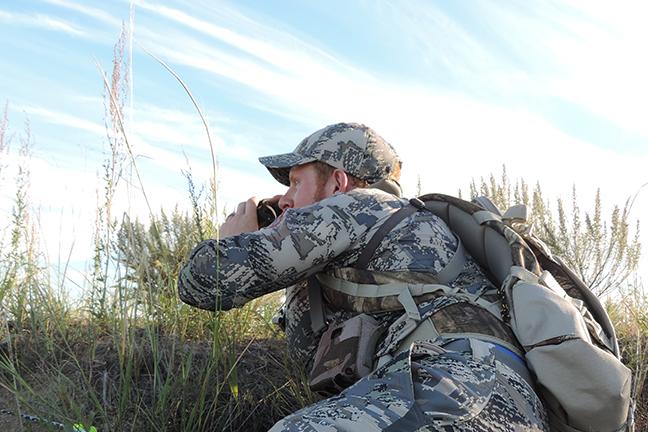 Hunter stalking antelope