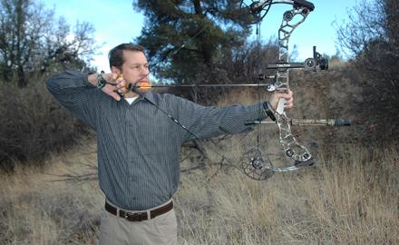 Hunter shooting bow