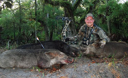 Editor Christian Berg poses with the trio of boars he killed during the first morning of his hunt with Osceola Outfitters. The hunt, while brief, was extremely exciting.